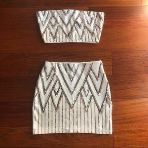 2-piece sparkly crop top and miniskirt.